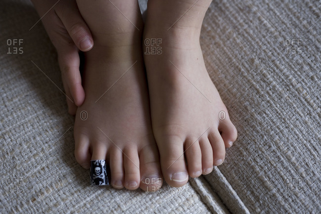 A boy's foot with a bandage