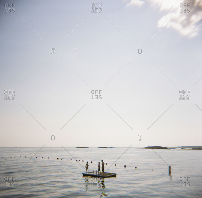 A family stands on a floating dock