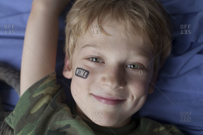 A boy with a temporary tattoo on his face