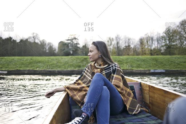 Woman relaxing in punt boat
