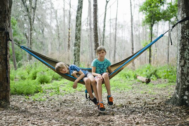 Children relaxing in a hammock