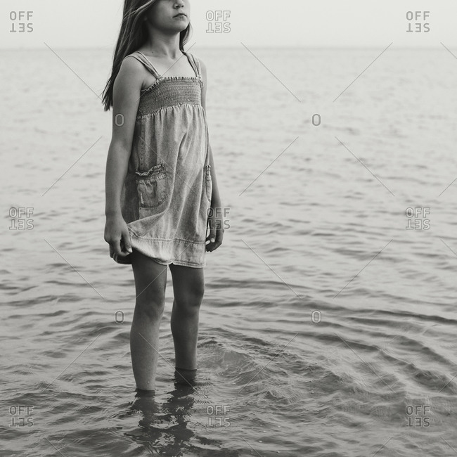 Girl standing in shallow water
