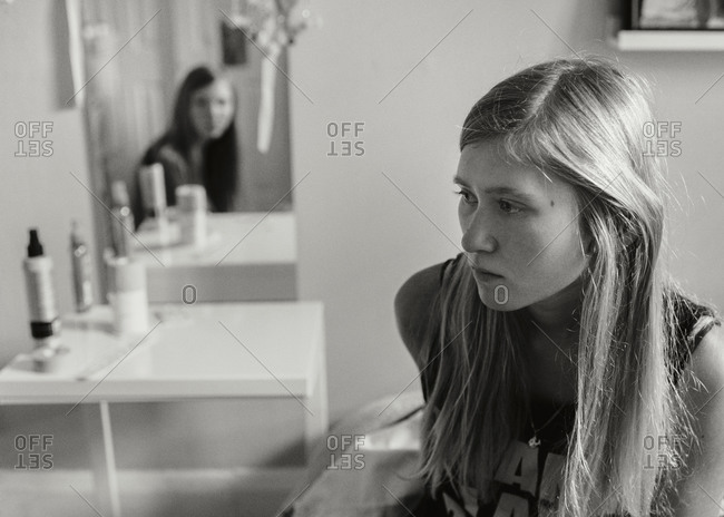 Portrait of a teen girl sitting in her room