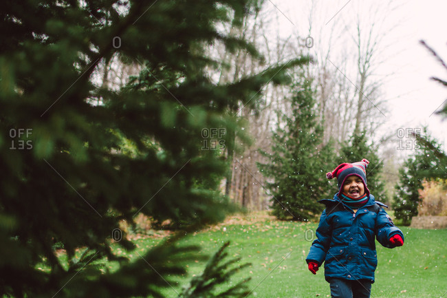 A little boy walks through season\'s first snow
