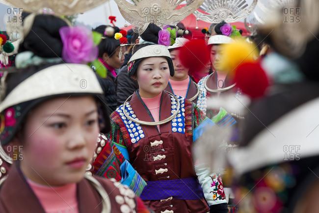 Kaili, Guizhou Province, China - January 26, 2012: Black Miao girls at a festival