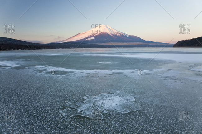 The frozen Lake Yamanaka with the snow-covered Mount Fuji in the background