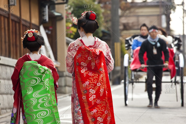 Geishas walking down the street in Kyoto, Japan