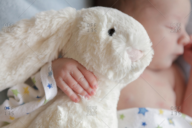 Baby asleep with stuffed rabbit