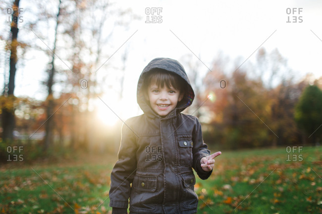 Boy in yard in fall jacket