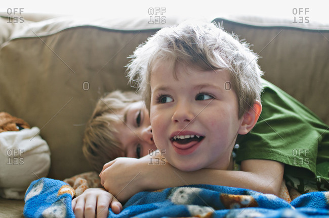 Two boys goofing around on couch
