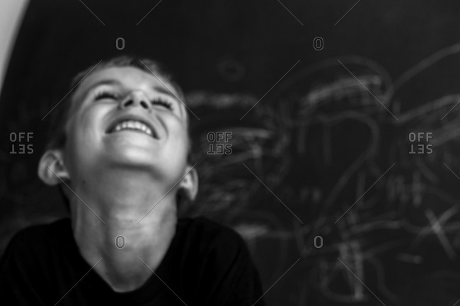 Child laughing with delight - Offset