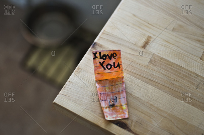 Love note from child on table\'s edge