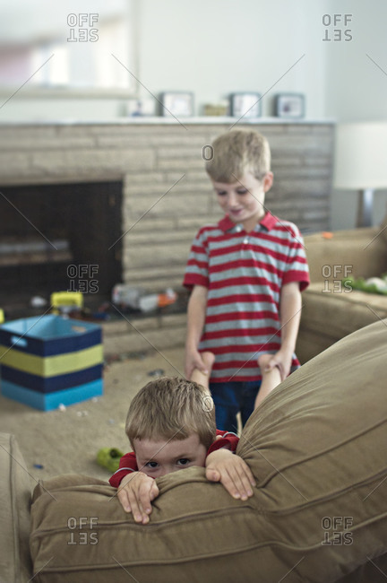 Two boys goofing around in living room