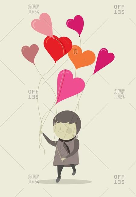 Woman carries heart balloons