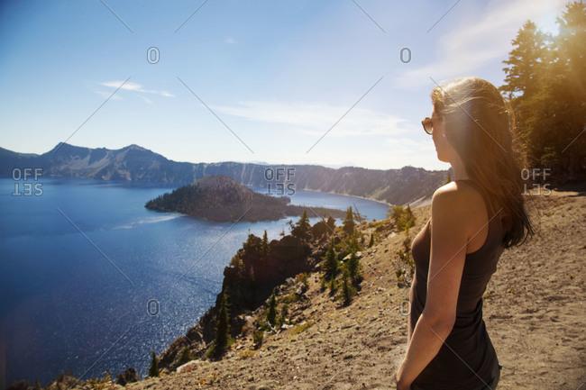 A woman enjoys a scenic mountain view