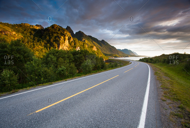 A road curves through a hilly Norwegian landscape