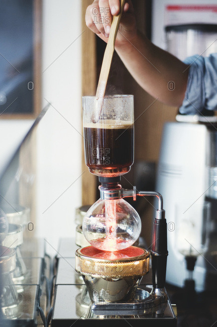 Syphon coffee being made in a cafe