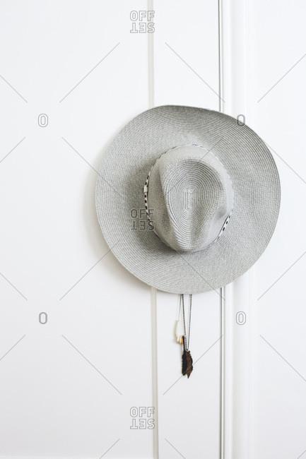 Summer hat hanging on door