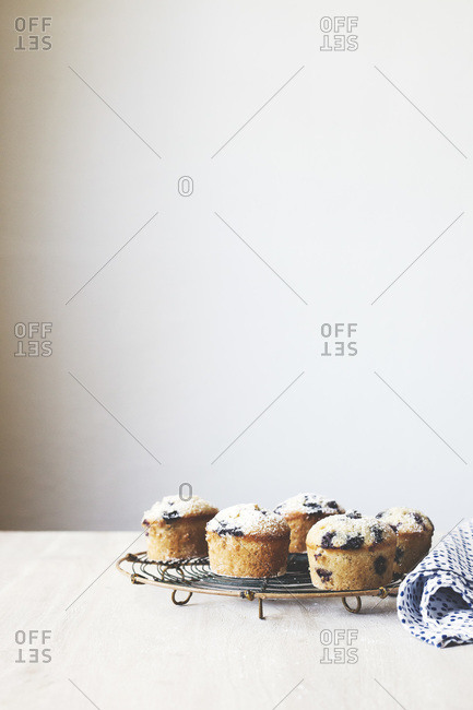 Blueberry friands served on a cooling rack