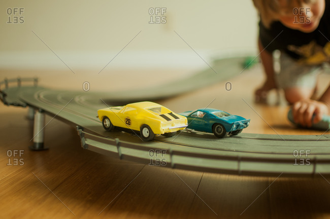A boy plays with toy cars