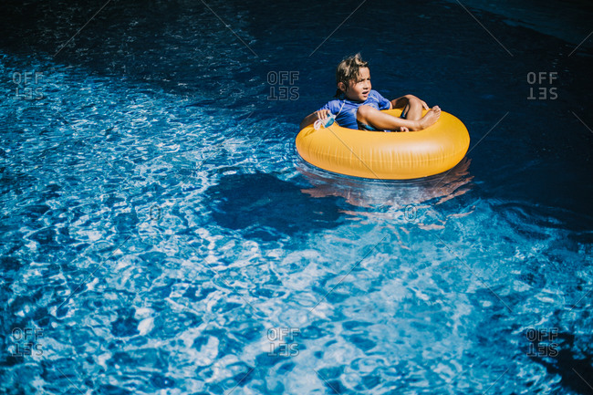 A boy floats in an inner tube