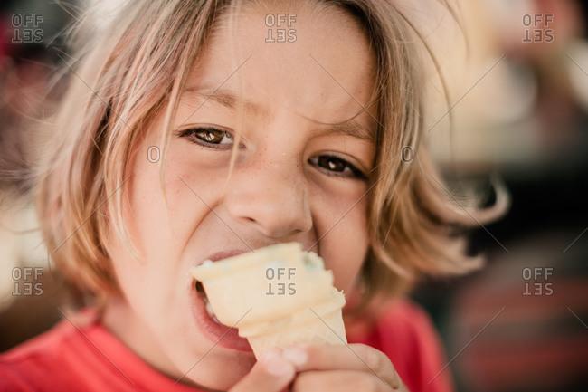 A boy eats ice cream