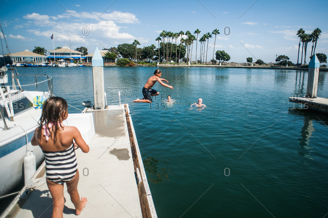 A family swims in a harbor