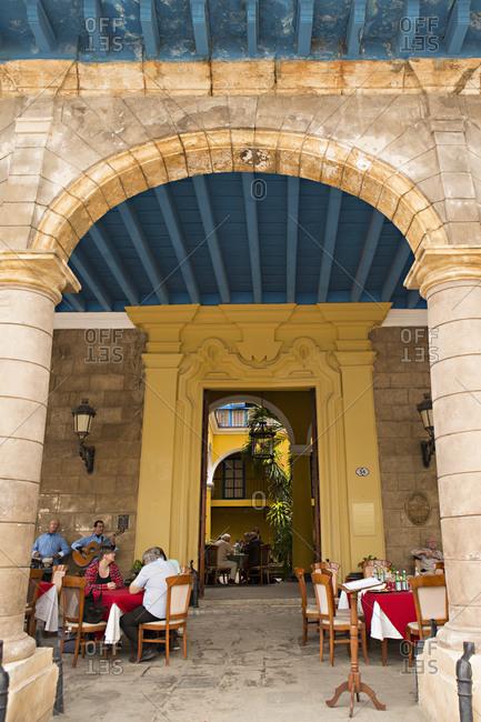 Havana, Cuba - January 24, 2016: People sitting at an outdoor restaurant