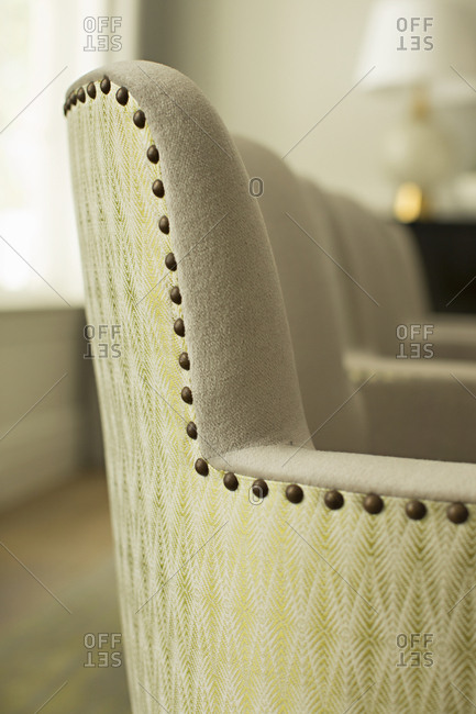 Detail of an upholstered chair with decorative tacks
