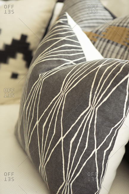A throw pillow with a  geometric pattern