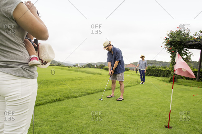 Family on a golf course