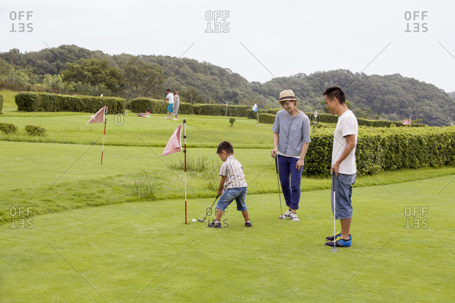 Family of three on a golf course