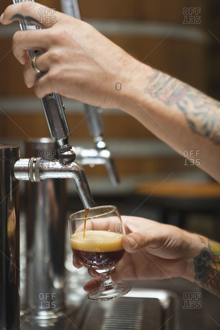 Bartender serving drought beer from a tap