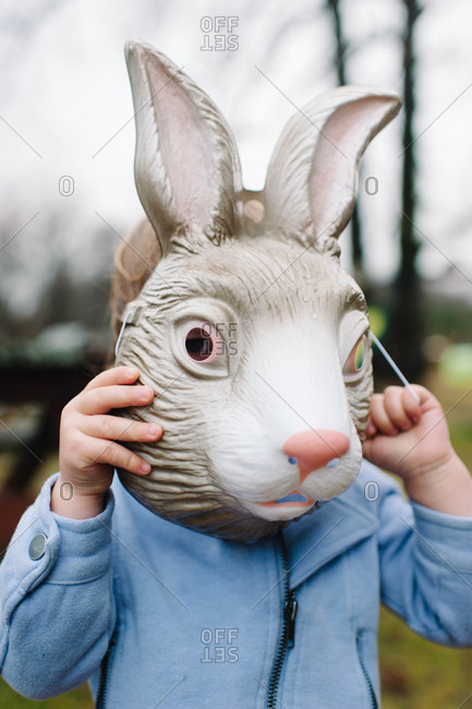 Child wearing a rabbit mask