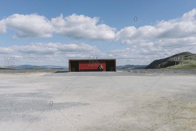 Hjerkinn, Norway - August 16, 2012: Man sitting at the Norwegian Wild Reindeer Centre in Norway