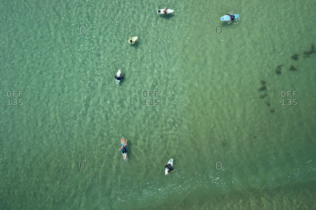 Aerial view of surfers in still water
