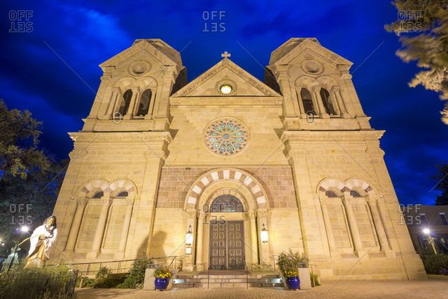 The historic Cathedral Basilica of St Francis of Assisi illuminated at night in Santa Fe, New Mexico