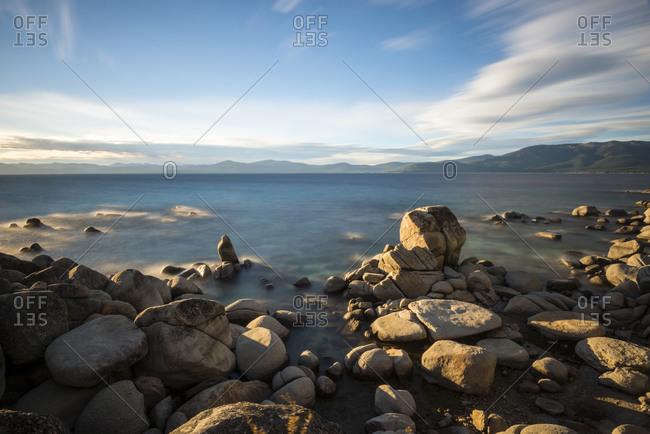 Late afternoon light illuminates the rocky east shore of Lake Tahoe, Nevada