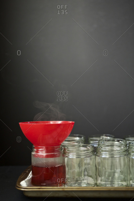 Funnel on top of a jar of quince jelly
