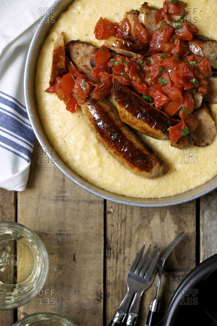 Turkey sausage with cheddar cheese grits and tomato sauce