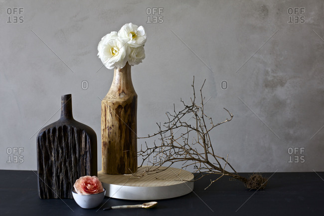 White peonies with an arrangement of objects