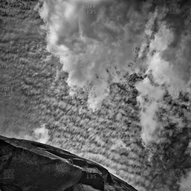 Upward view of a rock climber on the Washington Column, Yosemite National Park, California
