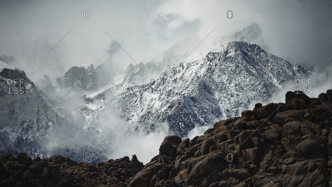 Mount Whitney above the Alabama Hills during a storm in Lone Pine, California