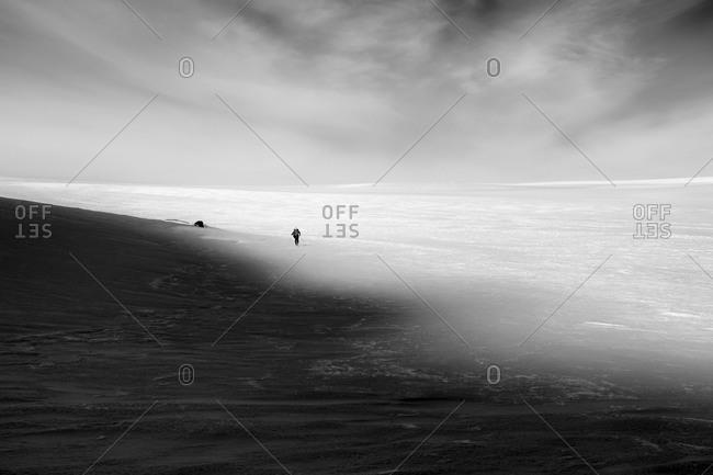 Skier in a barren landscape, Greenland