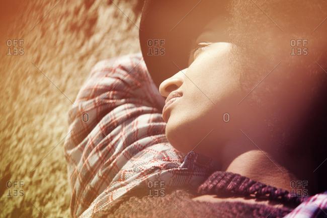 Stylish woman laying on ground