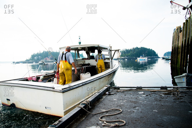 Man unloading crates from his fishing boat