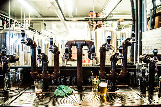 Glasses and beer spigots at a brewery