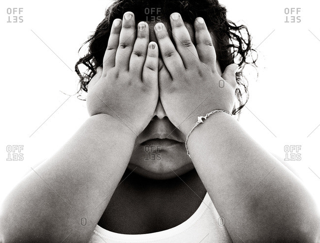 Overweight girl covering eyes