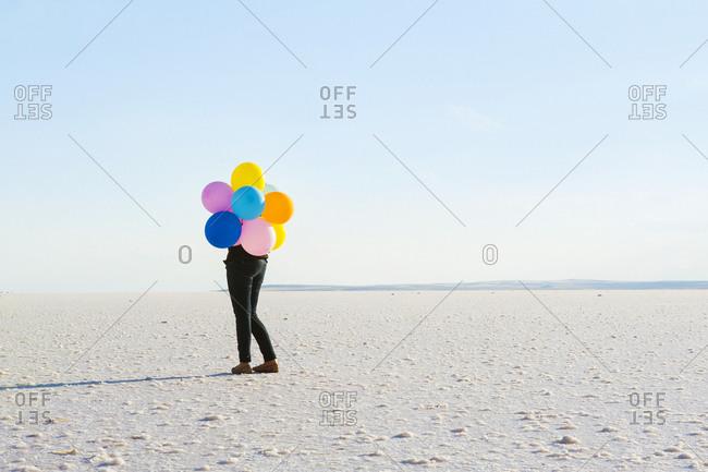 A girl with balloons on Tuz Gölü, salt lake in central Anatolia, Turkey