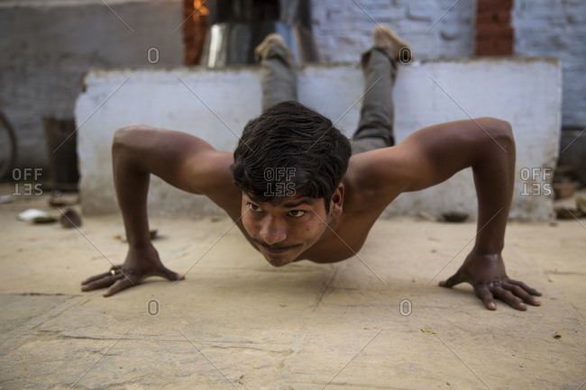 Varanasi, India - March 7, 2014: Kushti wrestler doing push ups, Varanasi, India
